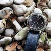 Brutal Blue vintage leather strap by gunny straps with a very distressed surface shown on panerai pam000 wristwatch