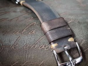Gurney 1 vintage leather strap by gunny straps with mysterious grey brown color shown on omega seamaster speedmaster wristwatch