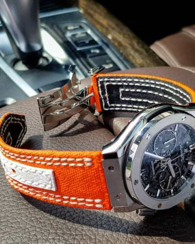 Clementine Canvas by gunny straps an orange canvas with white leather accent on this very sporty strap shown on hublot classic fusion wristwatch