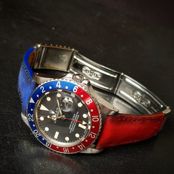 Suede bi color red and blue strap by Gunny Straps official online store shown on rolex pepsi gmt master