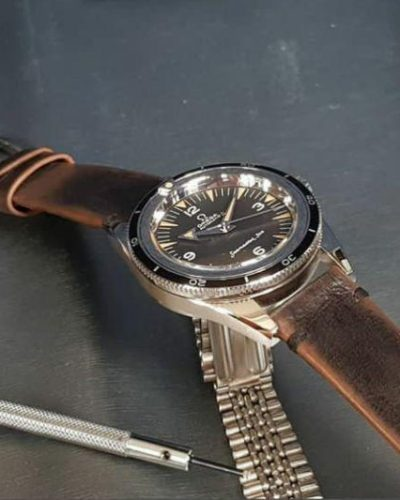 leather strap with minimalist and style and mysterious vintage brown color that created by gunny straps official online store called gurney 4 series shown on omega seamaster speedmaster railmaster rolex