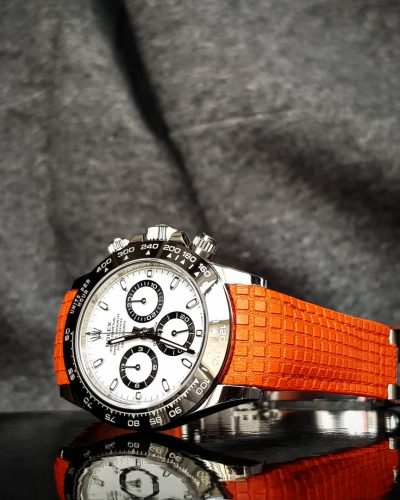 chessboard orange rolex daytona patek aquanaut